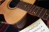 Hoe te spelen een gitaar met korte vingers