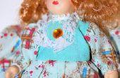 Het lijmen van een pop van haar