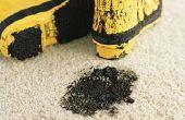 Hoe schoon natte modder uit witte tapijt