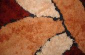 Hoe krijg ik lijm van de stof op het tapijt