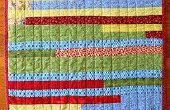 Hoe maak je een Quilt met behulp van de stof stroken
