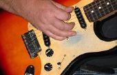 Hoe maak je een elektrische gitaar klinken als een bas