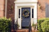 Hoe kiest u een kleur van de voordeur voor een huis van baksteen