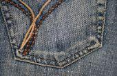 Het lijmen van steentjes op Jeans