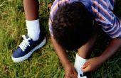 Hoe om een kind te binden schoenen te leren