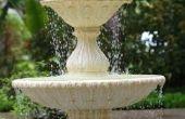 Water in mijn buiten fontein houdt draaien groen