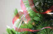 Technieken voor het plaatsen van linten rond een kerstboom