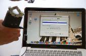 Hoe sluit een microfoon aan op een MacBook