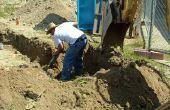 Het installeren van de afvoer leidingen voor een septische put jezelf