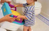 Trucs om kinderen te plassen in het Toilet