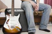 Het gebruik van een auto-accu voor het aandrijven van een gitaarversterker