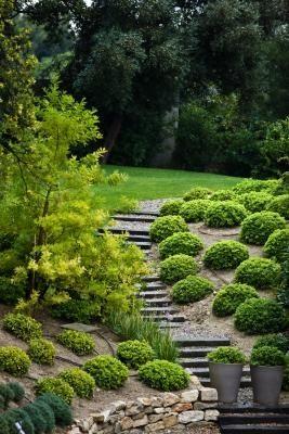 Hoe een schuine tuin terras for Terras op een helling